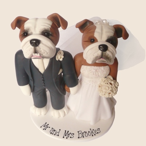 Wedding cake topper of couple as cute dogs