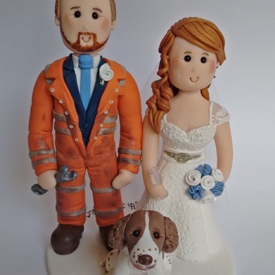 Wedding cake topper with groom as a mechanic