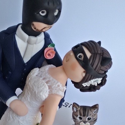 Wedding cake topper with couple as Batman and Catwoman