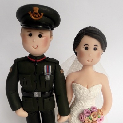 Wedding cake topper with groom in uniform