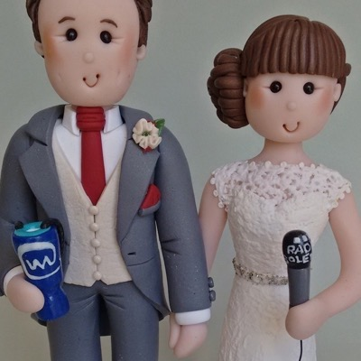 Wedding cake topper of couple with microphone