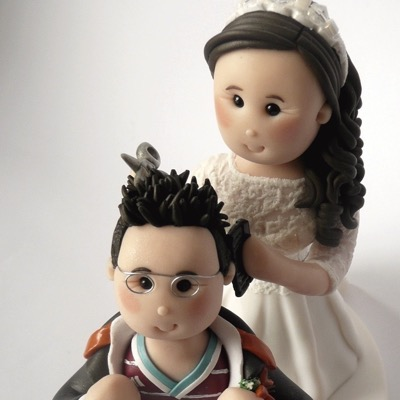 Wedding cake topper of couple hairdressing