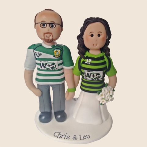 Fimo cake topper of couple in football shirts