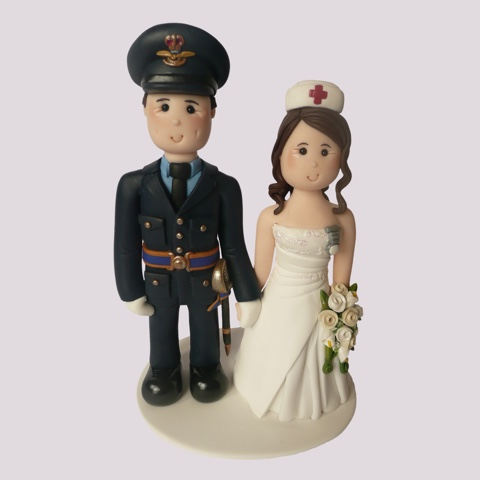 Wedding cake topper of officer and nurse in uniform
