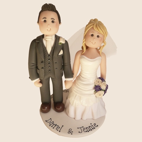 Hand-made wedding cake topper of bride and groom