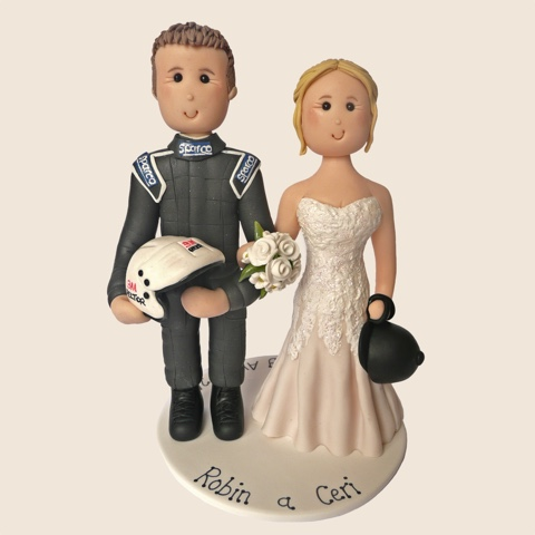 Wedding cake topper of racing driver with helmet