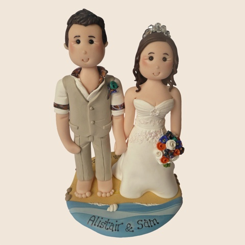 Wedding cake topper of couple on beach