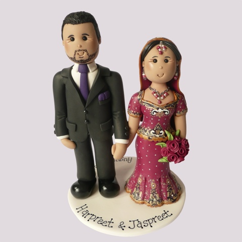 Wedding cake topper of Indian couple