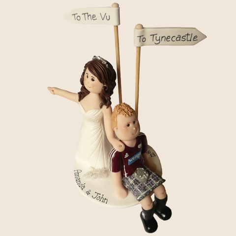 Wedding cake topper with groom in a kilt
