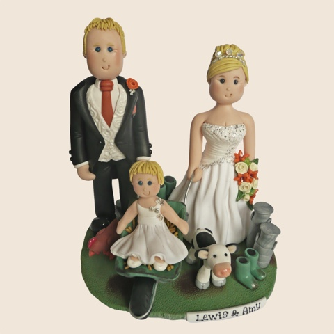 Wedding cake topper with child and pet